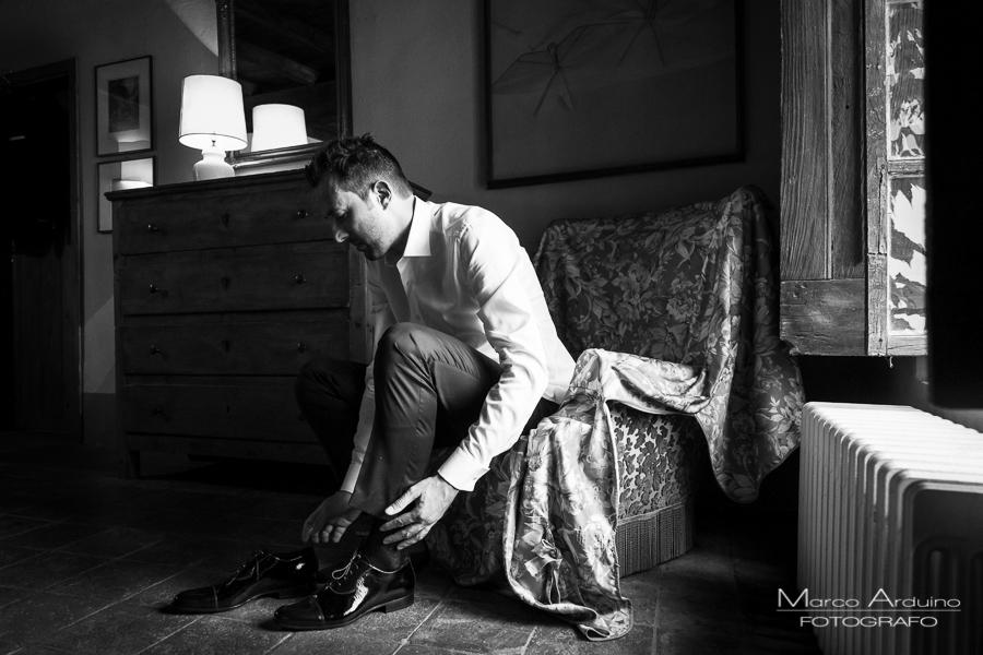 groom getting ready castle San Sebastiano Po Italy
